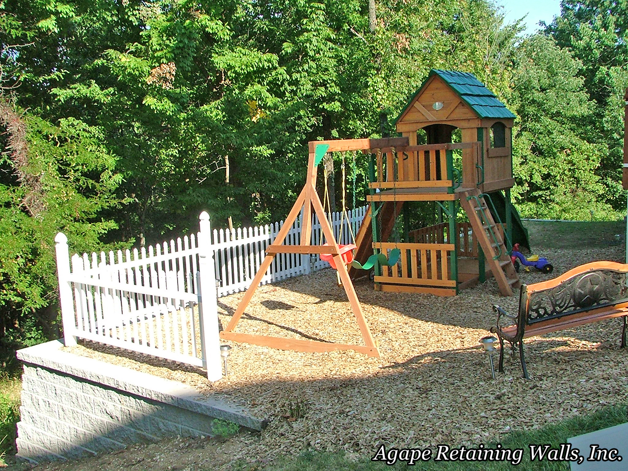 swingset on top portion of retaining wall garden yard