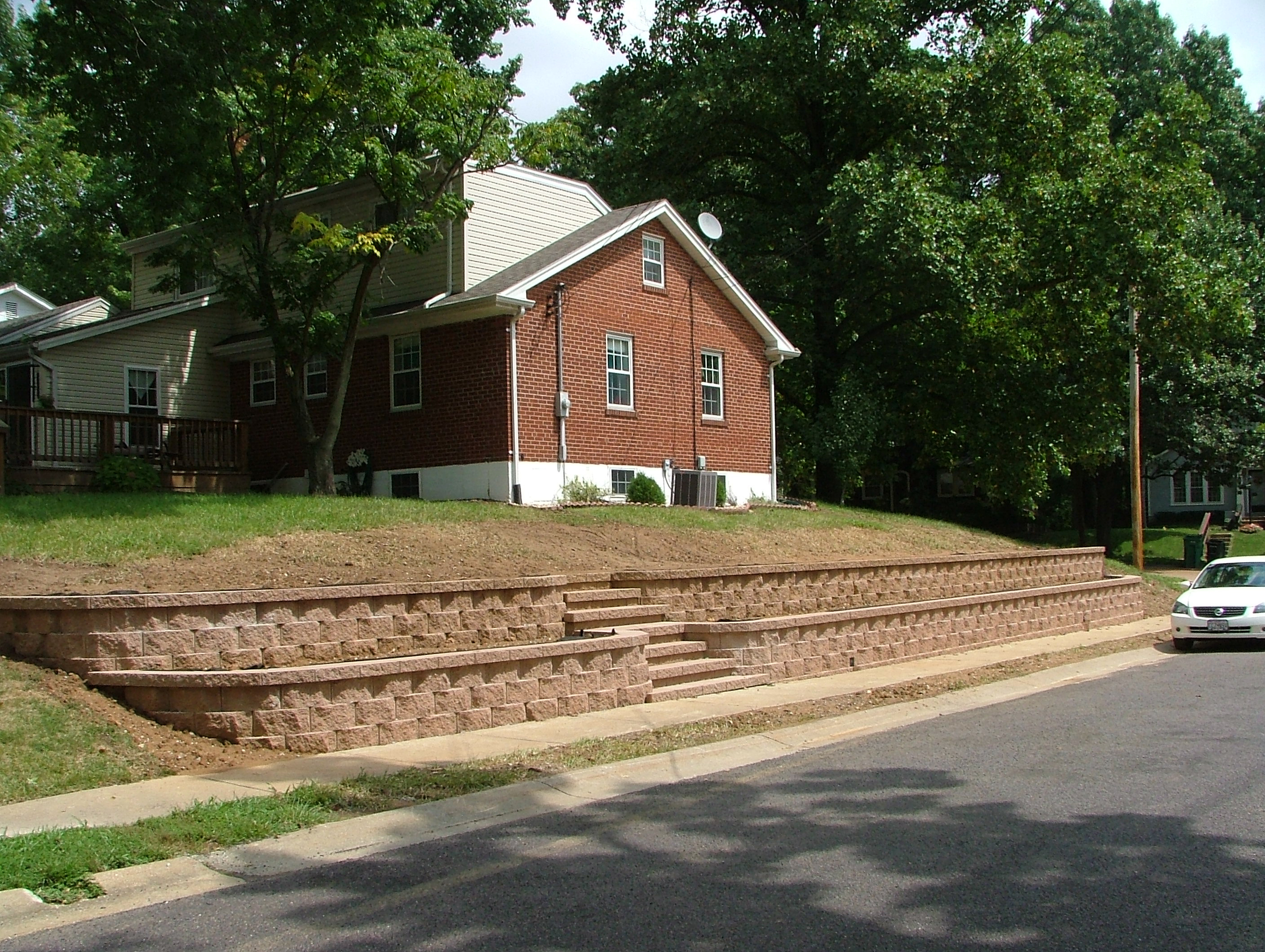 we at agape retaining walls inc designed and installed this great looking landscape terraced retaining wall with concrete block steps in 2009 - Retaining Wall Blocks Design