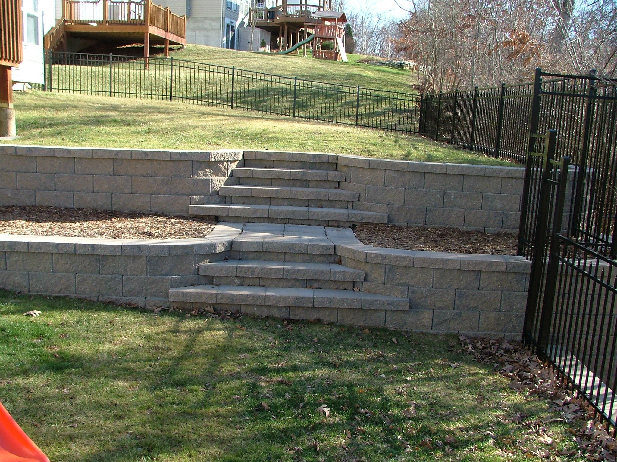 Techo bloc 39 s semma retaining wall block outdoor space for Terrace steps