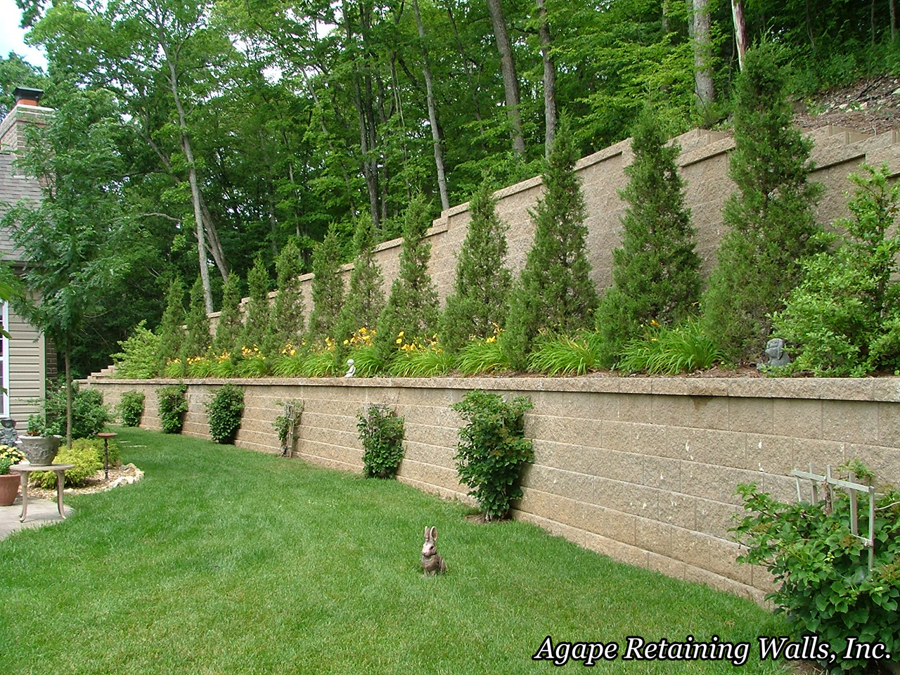 many times the topography dictates our hardscape design this set of retaining wall terraces with steps in st peters mo is one of those times