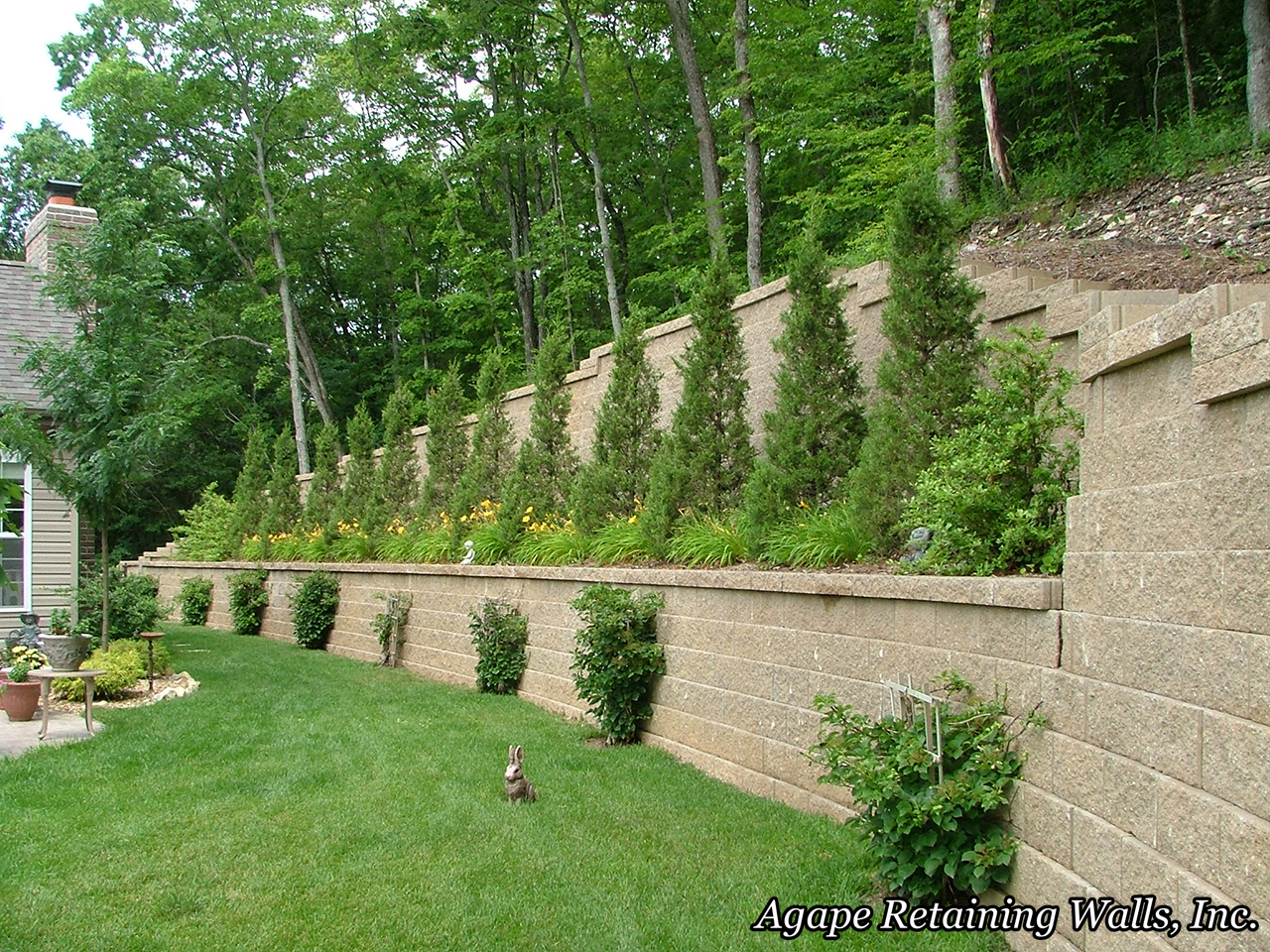 many times the topography dictates our hardscape design this set of retaining wall terraces with steps in st peters mo is one of those times - Segmental Retaining Wall Design 2